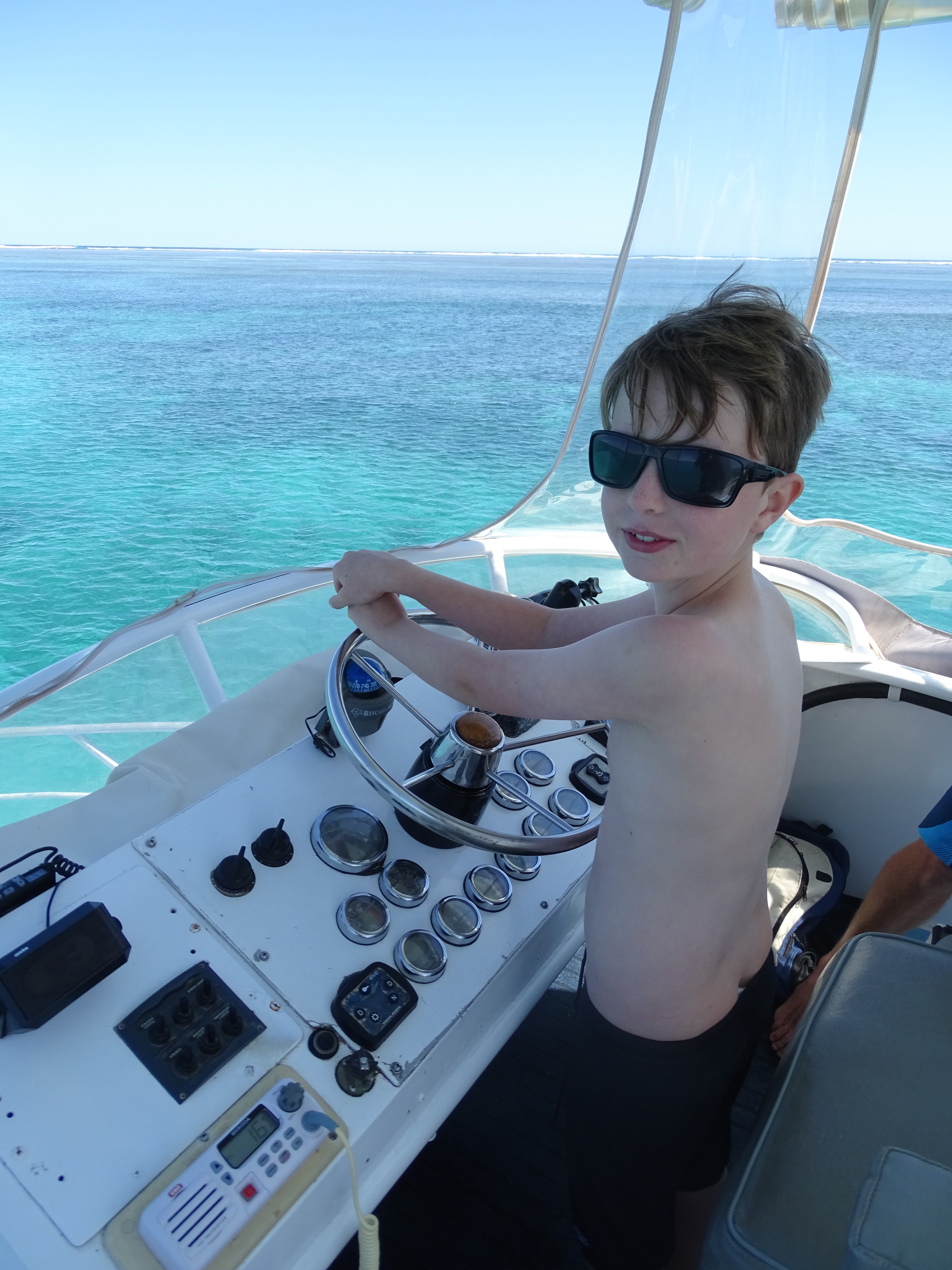 Driving the dive boat on Ningaloo Reef.